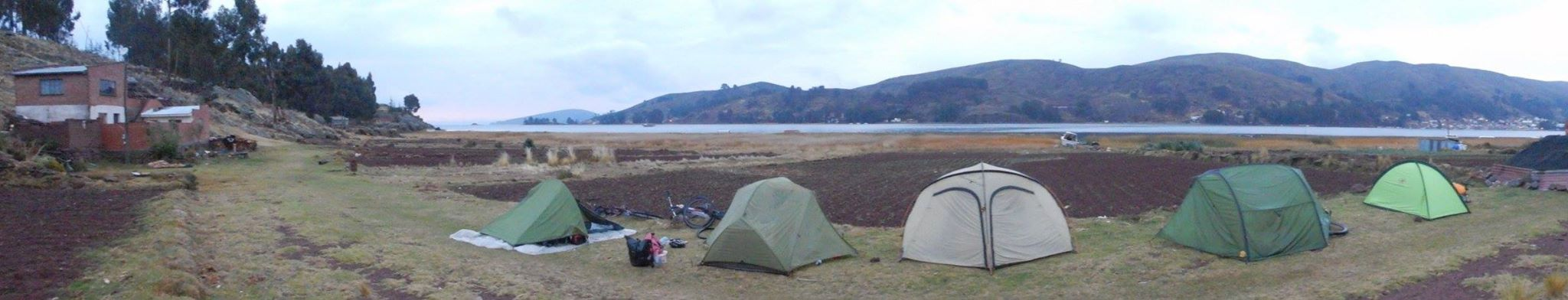 5 tents set up along the Lake umongst farmland