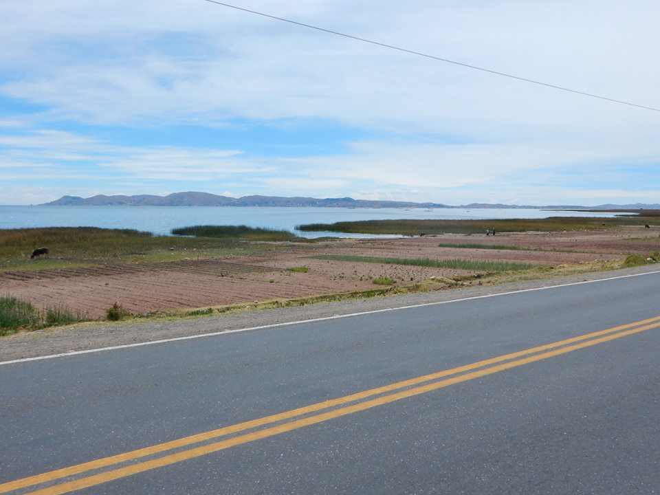 Road hugged Lake Titicaca